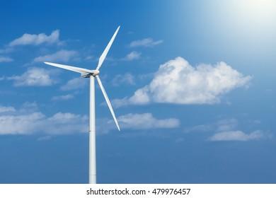Energy windmill produce energy on blue sky at daytime