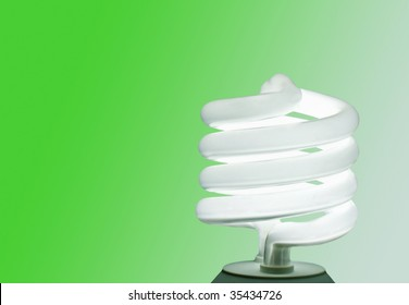 An energy-efficient CFL bulb illuminating a green background