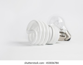 Energy-saving lamp and incandescent bulb isolated on a white background