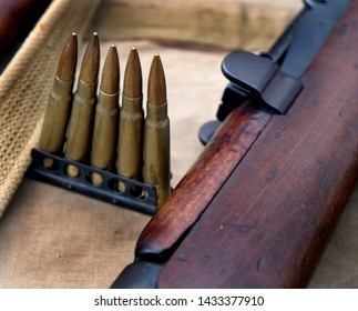 Enfield bolt action 0.303 military rifle and ammunition.