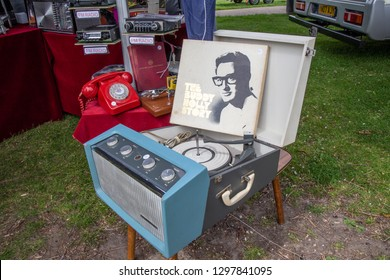 Enfield, Middlesex, UK - May 24, 2015: Old vintage record player standing on a small table.  Lid is open and a record of Buddy Holly Story is propped up agains the lid the the gramophone.
