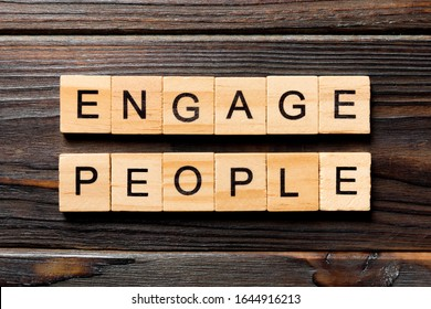 ENGAGE PEOPLE word written on wood block. ENGAGE PEOPLE text on wooden table for your desing, concept.