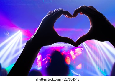 engage your audience with the power of music, with a heart shaped hands shadow