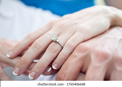 engaged couple with hands and engagement ring