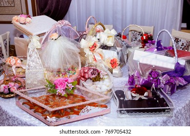 Engagement basket . Basket with sweets stands on the table .