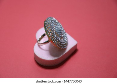 Engagement Daimond Ring with Heart Shape object on Red Background
