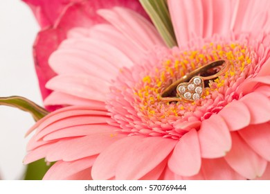 Engagement ring in a beautiful pink flower. Closeup