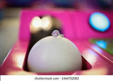 Engagement Ring Detail Shot on a Skee Ball in an Arcade