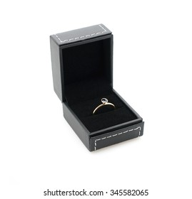 engagement ring in gift box isolated on white background. wedding