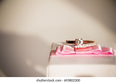 engagement ring. a gold ring lies on present box. Marriage proposal. ring with diamonds
