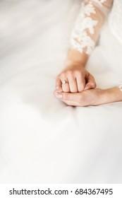 Engagement ring on bride's finger.