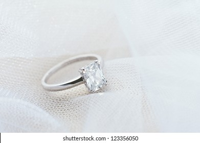 Engagement ring on white veil for Valentines Day or other romantic occasions