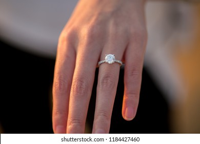 Engagement Ring On Woman's Hand During Sunset