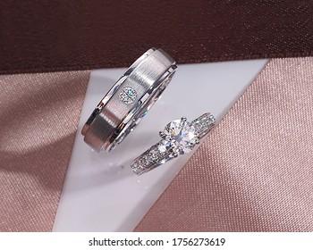 engagement wedding diamond ring for couple. pink ribbon.
