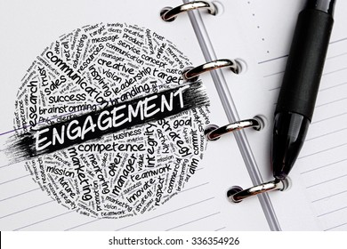 ENGAGEMENT word concept written on notebook