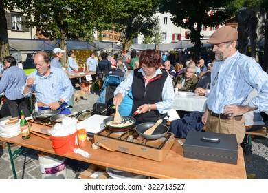 Engelberg, Switzerland - 26 September 2015: People preparing food at the autumn festival at Engelberg on the Swiss alps