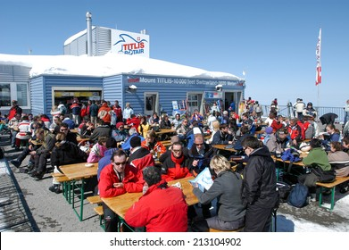 Engelberg, Switzerland - 28 March 2004: Sci tourists drinking and eating at the restaurant on mount Titlis over Engelgerg on the Swiss alps