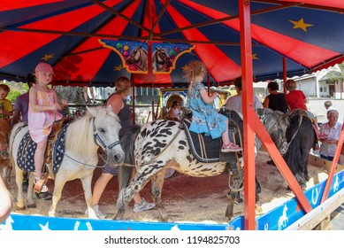 Engelberg, Switzerland - 31 July 2017: children riding horses on the carousel at Engelberg on the Swiss alps