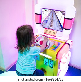 Engels, Russia - August 28, 2018: A child plays on a slot machine for children in an entertainment center