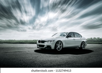 Engels, Russia - June 04, 2018: White car BMW 3 Series F30 is parked on empty countryside asphalt road at daytime