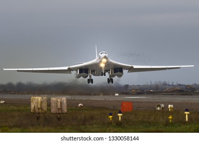 Engels, Saratov Region, Russia - November 08,2012: Routine busy day at the airbase. Flying of Tu-160 (a supersonic, variable-sweep wing heavy strategic bomber) with birds