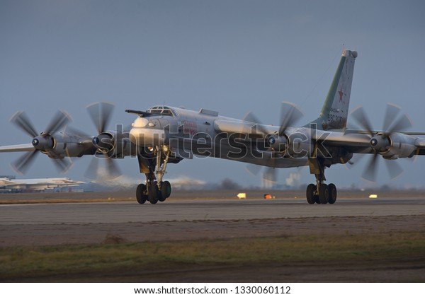 Engels, Saratov Region, Russia - November 08,2012: Routine busy day at the airbase. Flying of Tu-95 (is a large, four-engine turboprop-powered strategic bomber and missile platform)