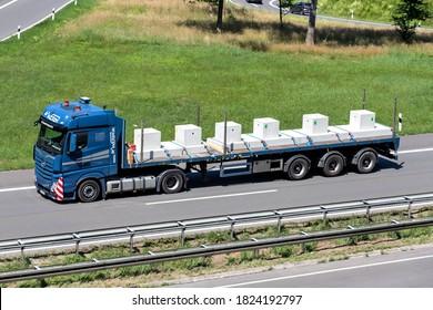 ENGELSKIRCHEN, GERMANY - JUNE 24, 2020: Wocken Mercedes-Benz Actros truck with flatbed trailer on motorway.