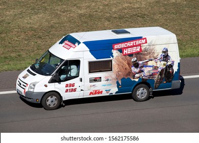 ENGELSKIRCHEN, GERMANY - SEPTEMBER 21, 2019: Sidecarteam Heier Ford Transit van on motorway.