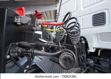 Engine and compressed air hoses of a truck