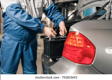 Engine engineer is replacing car battery because car battery is depleted. concept car maintenance