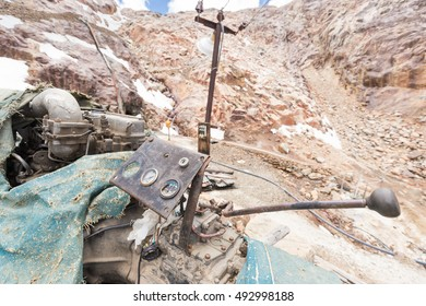 Engine mechanism lever  arm electric machine panel dashboard instrument industrial mine steel technology mountains rocks stones  Bolivia minery.