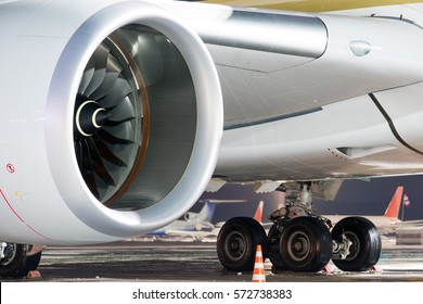 The engine of the modern passenger jet aircraft at night. Engine nacelle, air intake, fan blades and rotor close-up.