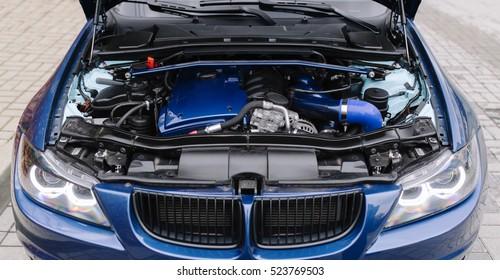 Engine motor of blue car under hood