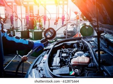Engine oil change. Car repair. Service station.
