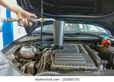 Engine oil is filled into a car engine