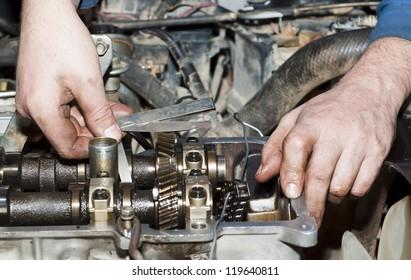 Engine repair close up. In hands tool.