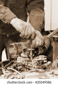 Engine repair close up. In hands tool. Sepia photo.