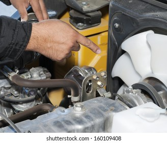 Engine repair. The worker shows on a detail.