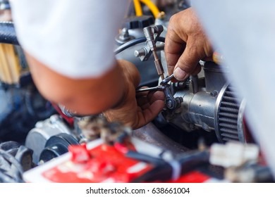 Engine repair,Mechanic working in a car under the hood,Engine repair service station.