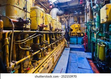 Engine room on a cargo boat ship, engine room on an oil platform, inside oil platform, inside ship