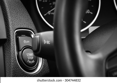 Engine start stop button in a modern passenger car.