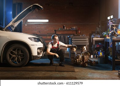 Engine tamer. Auto repair shop concept.