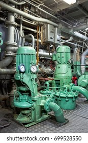 Engine water pumps in the pump room of the ship.