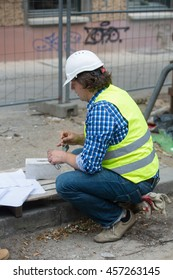 Engineer or architect checking plans on construction site