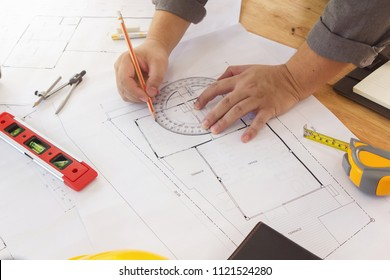 Engineer and Architect concept, Engineer Architects and real estate agent office team working with blueprints