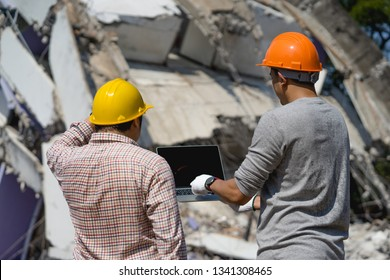 Engineer architect and contractor operation control demolish old building.Worker at building site