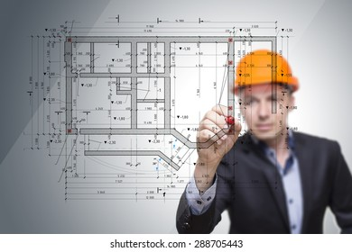 The engineer, architect draw the building plan on glass.