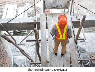Engineer or Architect inspecting inside building at construction site. He holding project blueprint papers and tablet.