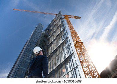engineer architect on construction site with laptop inspecting building