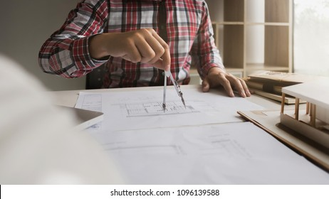 engineer architect woking on blueprint with tools - interior architect concept